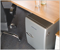A Waeco Mobicool F38 Mini Fridge is a neat addition to any office.